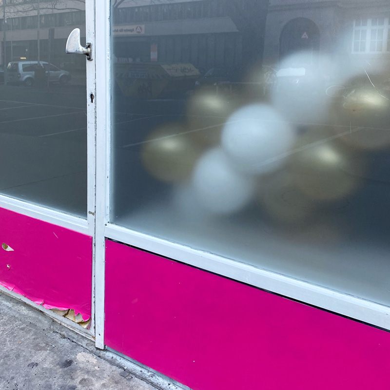 Photo of balloons behind a transulcent window