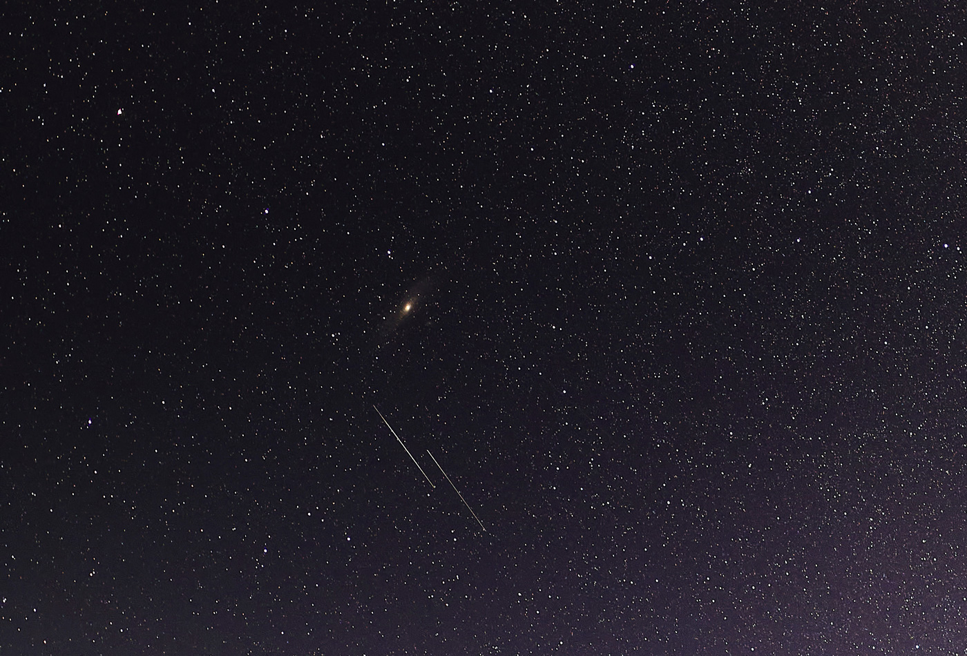 Photo of a night sky with meteors